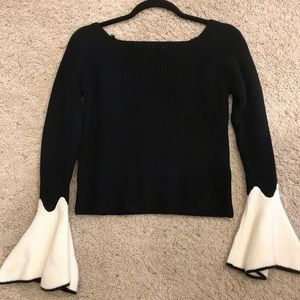 Haute Rogue black and white bell sleeve sweater